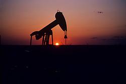 Pump Jack Silhouette, setting sun