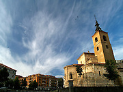 The San Millán Church, swirling swifts and wispy clouds, Segovia, Spain. Built in the 12th century, San Millán is the oldest church in Segovia and often overshadowed by the legendary city's other sights.