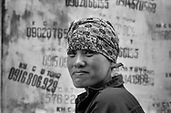 a woman is working in a house construction in Gia Lam.Hanoi, Vietnam.2009