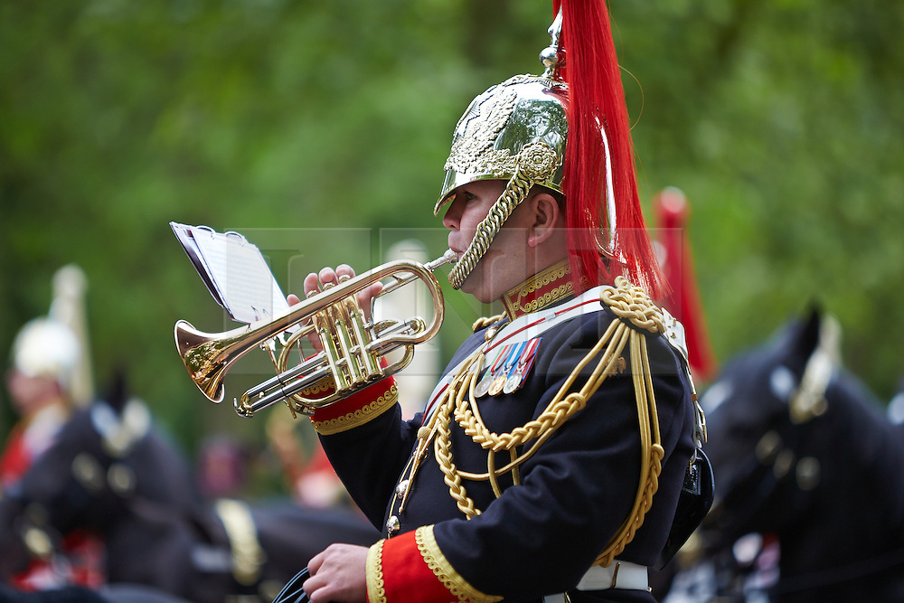 © Licensed to London News Pictures.  Members of the household cavalry parade down The Mall as part of the first dress reversal for Trooping The Colour known as the Major Generals Review. The full parade in front of the Queen occurs in two weeks time. Photo credit: Cliff Hide/LNP