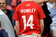 a young fan wears his Wembley t shirt . Skybet football league one play off final match , Leyton Orient  v Rotherham Utd at Wembley Stadium in  London on Sunday 25th May 2014.<br /> pic by John Patrick Fletcher, Andrew Orchard sports photography.