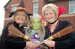 Guinness Northern Counties Housing Associations Godley Street  Scheme Hold a Halloween Street Party.left resident Mary Martin, with Guinness Northern Counties Housing Officer Shirley Adshead and daughter Ellen..30 October 2010 .Images © Paul David Drabble