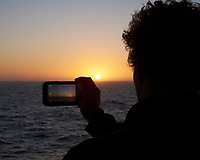 Picture in Picture of the Sun Rising over the Atlantic Ocean from the Aft Deck of the MV World Odyssey.Image taken with a Fuji X-T1 camera and 35 mm f/1.4 lens