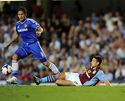 "Aston Villa's Ashley Westwood tackles Chelsea's Frank Lampard  - Photo mandatory by-line: Joe Meredith/JMP - Tel: Mobile: 07966 386802 21/08/2013 - SPORT - FOOTBALL - Stamford Bridge - London - Chelsea V Aston Villa - Barclays Premier League - EDITORIAL USE ONLY. No use with unauthorised audio, video, data, fixture lists, club/league logos or ""live"" services. Online in-match use limited to 45 images, no video emulation. No use in betting, games or single club/league/player publications"