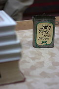 Israel, Jerusalem Jewish Prayer books and Charity box in a Synagogue