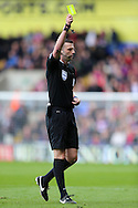 Referee Michael Oliver gives a Yellow card to Yannick Bolasie of Crystal Palace (not pictured). Barclays Premier League match, Crystal Palace v Norwich city at Selhurst Park in London on Saturday 9th April 2016. pic by John Patrick Fletcher, Andrew Orchard sports photography.