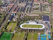 Nederland, Noord-Holland, Amsterdam; 23-03-2020; Jaap Edenbaan en sportvelden liggen er ongebruikt bij.<br /> Het publieke leven in het centrum van de hoofdstad is bijna geheel stil komen te liggen als gevolg van het Corona virus. Niet alleen is alle horeca dicht, ook veel winkels en andere bedrijven zijn gesloten. Het publiek blijft over het algemeen binnen, de straten en pleinen zijn stil.<br /> <br /> Public life in the center of the capital has come to a complete standstill as a result of the Corona virus. Not only are all pubs, coffee shops and restaurants,  closed, many shops and other companies are also closed. The public generally stays inside, the streets and squares are very quiet.<br /> <br /> luchtfoto (toeslag op standaard tarieven);<br /> aerial photo (additional fee required)<br /> copyright © 2020 foto/photo Siebe Swart