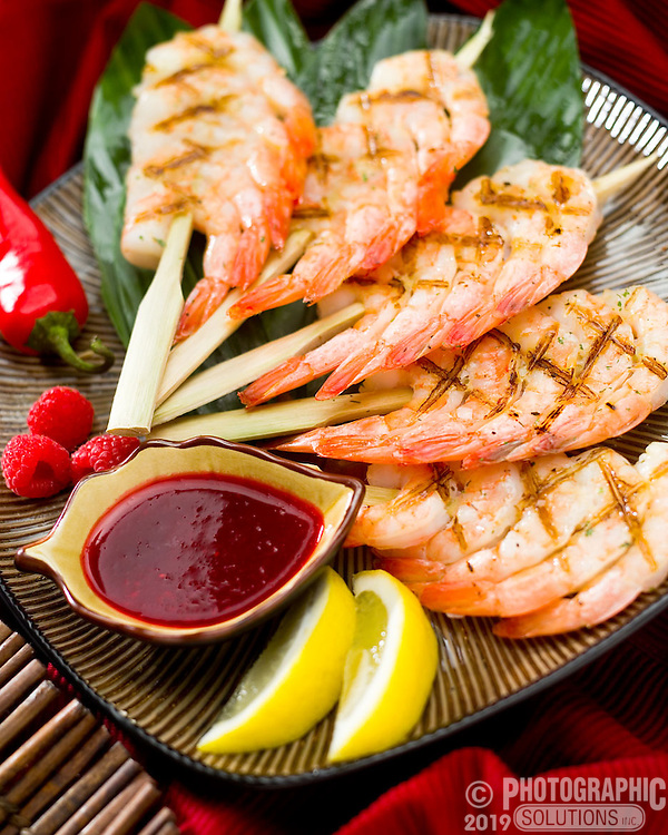 Raspberry prawns with dipping sauce and lemons