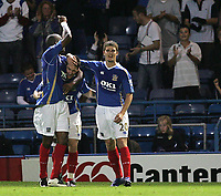 Photo: Lee Earle.<br /> Portsmouth v Leeds United. Carling Cup. 28/08/2007.David Nugent (C) is congratulated after scoring Portsmouth's third goal.