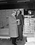 15th October 1952<br /> <br /> P.J. Carroll and Co. Ltd tobacco factory, Dundalk. Visit of Sean MacEntee, Minister for Finance, to the Factory.  Picture shows Mr. M. Kerley, Factory Manager, (right) showing the Minister some cartons of Carroll's Grand Parade cigarettes.