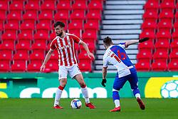 Morgan Fox of Stoke City finds his path blocked by Harvey Elliott of Blackburn Rovers - Mandatory by-line: Nick Browning/JMP - 19/12/2020 - FOOTBALL - Bet365 Stadium - Stoke-on-Trent, England - Stoke City v Blackburn Rovers - Sky Bet Championship