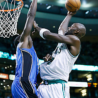 01 February 2013: Boston Celtics power forward Kevin Garnett (5) goes for the layup against Orlando Magic power forward Andrew Nicholson (44) during the Boston Celtics 97-84 victory over the Orlando Magic at the TD Garden, Boston, Massachusetts, USA.