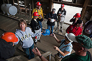 Tourists put on hard hats in preparation for a tour of the mill building with St. Elias Alpine Guides in Kennecott, Alaska, site of the historic Kennecott Copper Mine.