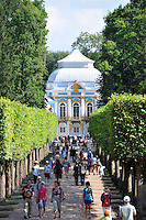 Summer tourists stream through the topiary gardens at the Catherine Palace at Tsarskoe Selo (Pushkin) near St. Petersburg, Russia.