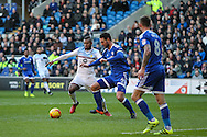 Sean Morrison of Cardiff City clears the ball, under pressure from Leandro Bacuna of Aston Villa during the EFL Sky Bet Championship match between Cardiff City and Aston Villa at the Cardiff City Stadium, Cardiff, Wales on 2 January 2017. Photo by Andrew Lewis.