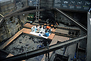 Employees Working in the Tar Pits At La Brea Tar Pits in Los Angeles