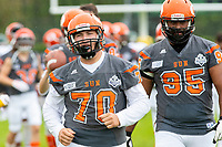 KELOWNA, BC - SEPTEMBER 22:  Lucas Spencer #70 and Karn Sidhu #95 of Okanagan Sun run onto the field at the start of the game against the Valley Huskers at the Apple Bowl on September 22, 2019 in Kelowna, Canada. (Photo by Marissa Baecker/Shoot the Breeze)