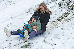 © Licensed to London News Pictures 10/02/2021.        Rochester, UK. Mum Jade, sledging with her son Parker age two in Rochester, Kent. Temperatures are set to drop to a freezing cold -7C in Kent and the South East tonight with more snowfall expected. Photo credit:Grant Falvey/LNP