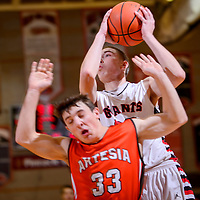 010815       Cable Hoover<br /> <br /> Grants Pirate Richie Lucero (32) collides with Artesia Bulldog Ethan Duff (33) as he drives to the hoop during the Gallup Boys Invitational at Gallup High School Thursday.