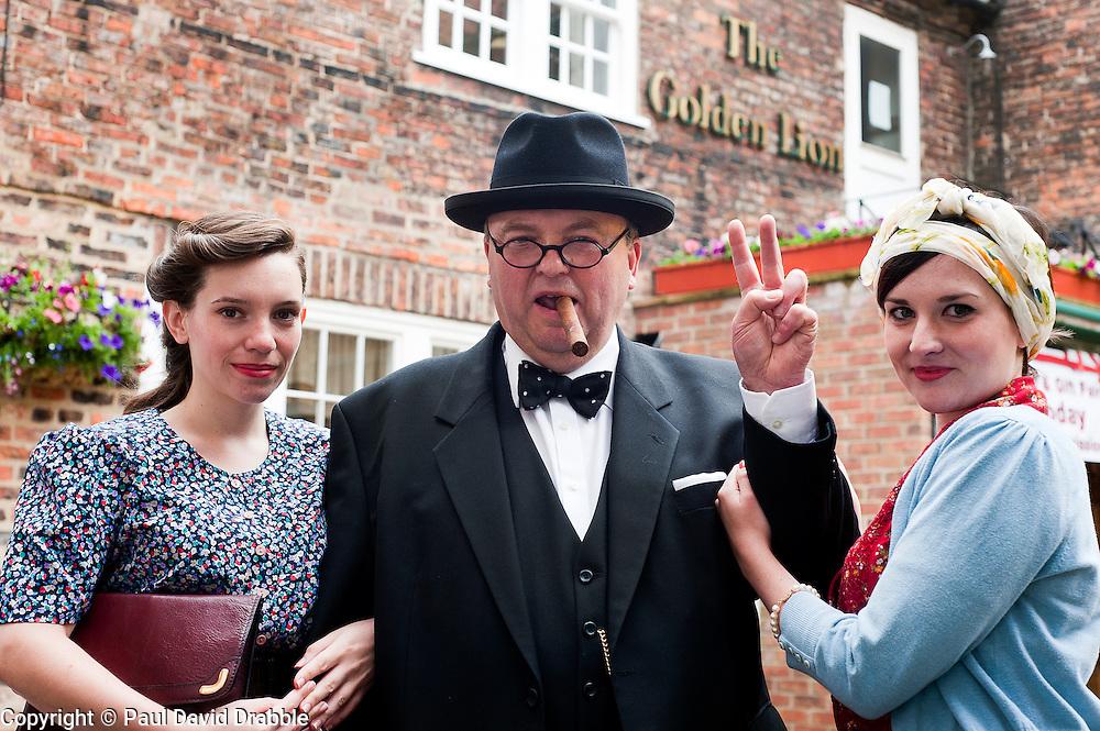 Reenactor and Look-a-like Derek Herbert portrays Britains Lgenedary Wartime leader Winston Churchill at the Northallerton Wartime Weekend.<br /> Image © Paul David Drabble
