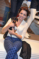 OPHELIA LOVIBOND and her dog Frankie at a party to celebratethe opening of the Lacoste Flagship Store at 44 Brompton Road, Knightsbridge, London on 20th June 2012.