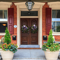 Strasburg, PA / USA - June 26, 2011: A home with a distinctive porch, and double door entrance is on the main street in the quaint, Lancaster County town.