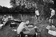 Melden, Belgium, 28 may 2017, 32°C - Friends swim in the 'Schijtput' (cesspool), an old brach of the river Scheldt  (out of the series from ongoing project about scheldt and meuse)