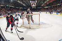 KELOWNA, CANADA - JANUARY 4: Ted Brennan #10 of the Kelowna Rockets stick checks Cole Beamin #3 of the Prince George Cougars as he skates behind the net with the puck during third period on January 4, 2019 at Prospera Place in Kelowna, British Columbia, Canada.  (Photo by Marissa Baecker/Shoot the Breeze)