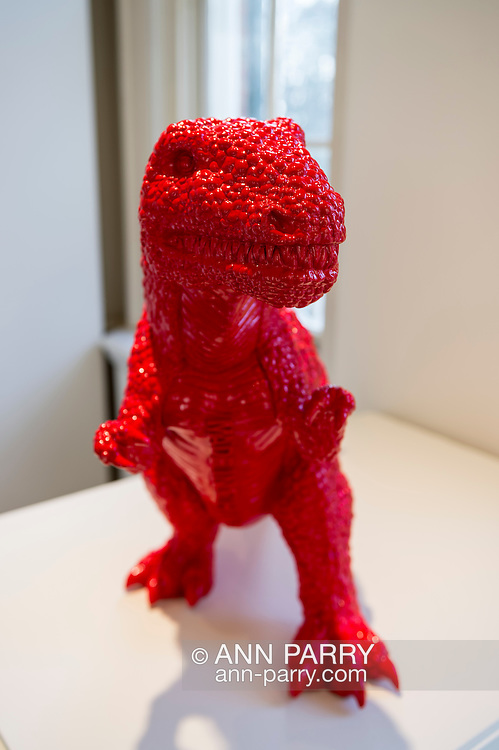 "Roslyn, New York, USA. January 2, 2015. Dinosaur (2006) in red polyresin, by Chinese artist Sui Jianguo (b. 1956) is displayed at the Nassau County Museum of Art China Now and Then Exhibit. ""MADE IN CHINA"" is written in big block letters down his chest."