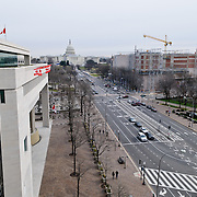 From 6 floors up, the Newseum offers an unobstructed view of the US Capitol along Pennsylvania Avenue. The building right next to the Newseum is the Canadian Embassy. The Newseum is a 7-story, privately funded museum dedicated to journalism and news. It opened at its current location on Pennsylvania Avenue in April 2008.