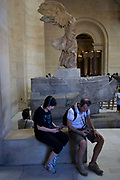 Tourists listen to audio guided tour commentary using free Nintendos beneath the statue of Nike, the ancient Greek Godess of Victory in the Louvre, Paris. The Musée du Louvre is one of the world's largest museums, the most visited art museum in the world and a historic monument. A central landmark of Paris, France, it is located on the Right Bank of the Seine in the 1st arrondissement (district). Nearly 100,000 objects from prehistory to the 19th century are exhibited over an area of 60,600 square metres (652,300 square feet).