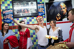 © Licensed to London News Pictures . 27/12/2018. Wigan, UK. Party-goers dressed as Freddie Mercury and Britney Spears amongst others , in the Godfather takeaway . Revellers in Wigan enjoy Boxing Day drinks and clubbing in Wigan Wallgate . In recent years a tradition has been established in which people go out wearing fancy-dress costumes on Boxing Day night . Photo credit: Joel Goodman/LNP