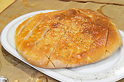 Traditional bread with sesame seeds. Efendi Efendy traditional Turkish and Ottoman Restaurant, The Block, Tirana. Albania, Balkan, Europe.