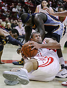 Feb 5, 2011; Houston, TX, USA; Houston Rockets power forward Luis Scola (4) grabs a loose ball from Memphis Grizzlies power forward Zach Randolph (50) during the third quarter at the Toyota Center.  The Rockets won 95-93. Mandatory Credit: Thomas Campbell-US Presswire
