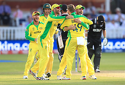 Australia's Steve Smith (centre) celebrates the wicket of New Zealand's Colin de Grandhomme with team-mates during the ICC Cricket World Cup group stage match at Lord's, London.