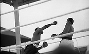 Ali vs Lewis Fight, Croke Park,Dublin..1972..19.07.1972..07.19.1972..19th July 1972..As part of his built up for a World Championship attempt against the current champion, 'Smokin' Joe Frazier,Muhammad Ali fought Al 'Blue' Lewis at Croke Park,Dublin,Ireland. Muhammad Ali won the fight with a TKO when the fight was stopped in the eleventh round...Photograph of Lewis throwing a wild right towards the head of Ali