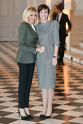 French President's wife Brigitte Macron welcomes Belgian Prime Minister's partner Amelie Derbaudrenghien as they take part in a spousal event at the Chateau de Versailles in Versailles, near Paris, on November 11, 2018 as part of commemorations marking the 100th anniversary of the 11 November 1918 armistice, ending World War I. Photo By Laurent Zabulon/ABACAPRESS.COM