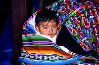 Baby wrapped in shawl carried on mother's back, Market Day, Chichicastenango, Western Highlands, Guatemala