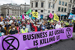 London, UK. 3rd September, 2020. Climate activists from Extinction Rebellion attend a 'Carnival of Corruption' protest against the government's facilitation and funding of the fossil fuel industry. Extinction Rebellion activists are attending a series of September Rebellion protests around the UK to call on politicians to back the Climate and Ecological Emergency Bill (CEE Bill) which requires, among other measures, a serious plan to deal with the UK's share of emissions and to halt critical rises in global temperatures and for ordinary people to be involved in future environmental planning by means of a Citizens' Assembly.
