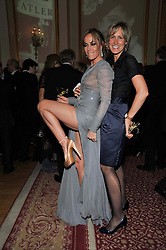 Left to right, sisters TARA PALMER-TOMKINSON and SANTA SEBAG-MONTEFIORE at a party to celebrate 300 years of Tatler magazine held at Lancaster House, London on 14th October 2009.