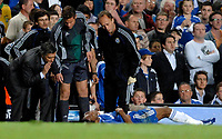 Photo: Richard Lane.<br />Chelsea v Liverpool. UEFA Champions League. Semi Final, 1st Leg. 25/04/2007. <br />Chelsea manager Jose Mourinho speaks to an injured Didier Drogba.