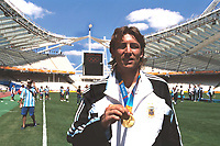 Gabriel Heinze (Argentina) who has recently signed for Manchester United celebrates with his gold Medal in front of the Olympic Flame.Mens Football Final. Argentina v Paraguay.28/8/2004.Athens Olympics 2004.Credit : Colorsport/Andew Cowie