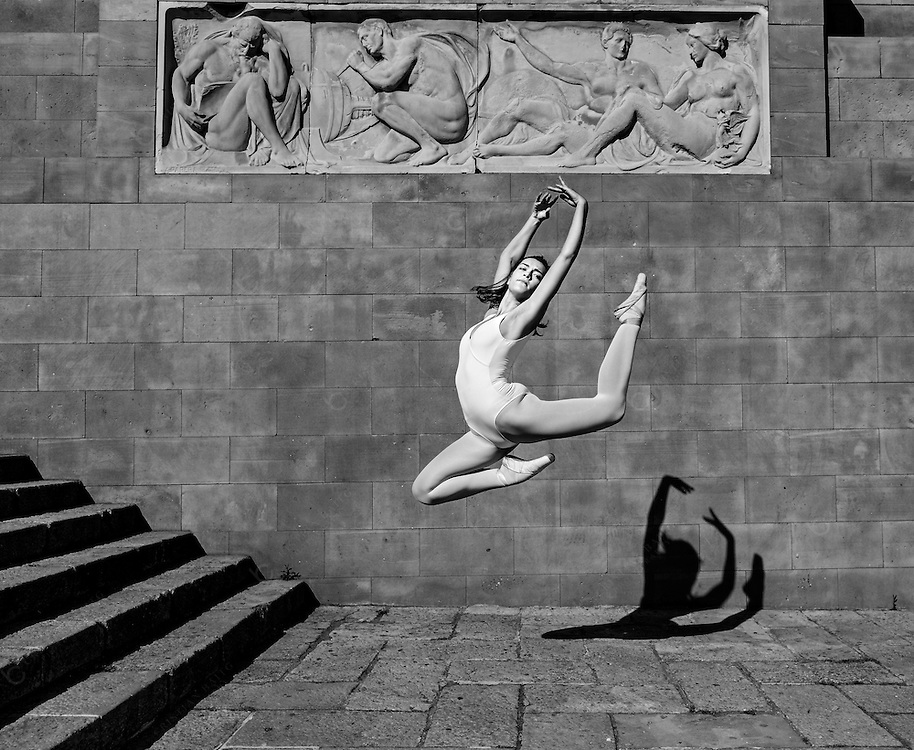 Ballet dancer jumping in the city<br /> <br /> Note to inspection: The greek relief in the wall is from artist Antonio Parera who build it in 1929 so the statue is more than 75 years old and is on public ground so it falls under public domain category<br /> <br /> See:<br /> http://w10.bcn.es/APPS/gmocataleg_monum/FitxaMonumentAc.do?idioma=CA&codiMonumIntern=576