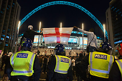 © Licensed to London News Pictures.  07/07/2021. London, UK. England football supporters celebrate their victory over Denmark at Wembley Stadium, west London during the semi-finals EURO 2020.  Photo credit: Marcin Nowak/LNP