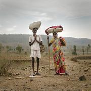 A Hindu pilgrim couple circumambulating the holy Naramda river.<br /> Madhya Pradesh Province.