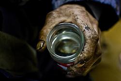 Yasu, an unemployed day laborer, drinks $1 sake in Kamagasaki, Japan.