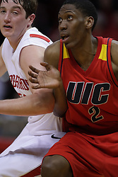 11 December 2010: Blake Mishler and Paul Carter dual for position for a  free throw rebound during an NCAA basketball game between the Illinois - Chicago Flames (UIC) and the Illinois State Redbirds (ISU) at Redbird Arena in Normal Illinois.