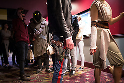 © Licensed to London News Pictures . 17/12/2015 . Manchester , UK . Han Solo 's low slung gun belt in the queue ahead of the midnight screening . Star Wars fans attend the midnight screening of Star Wars the Force Awakens at the AMC Great Northern cinema in Manchester City Centre . Photo credit : Joel Goodman/LNP