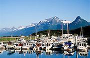 Alaska. Valdez boat harbor with  Chugach Mts beyond.
