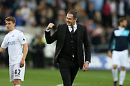 Paul Clement, the Swansea city manager © celebrates on the pitch at full-time after his team win the match 1-0. Premier league match, Swansea city v Everton at the Liberty Stadium in Swansea, South Wales on Saturday 6th May 2017.<br /> pic by  Andrew Orchard,